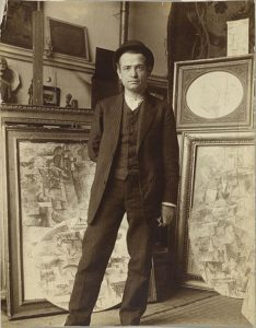 Auguste_Herbin_in_Pablo_Picasso's_studio_on_Boulevard_de_Clichy,_early_1911